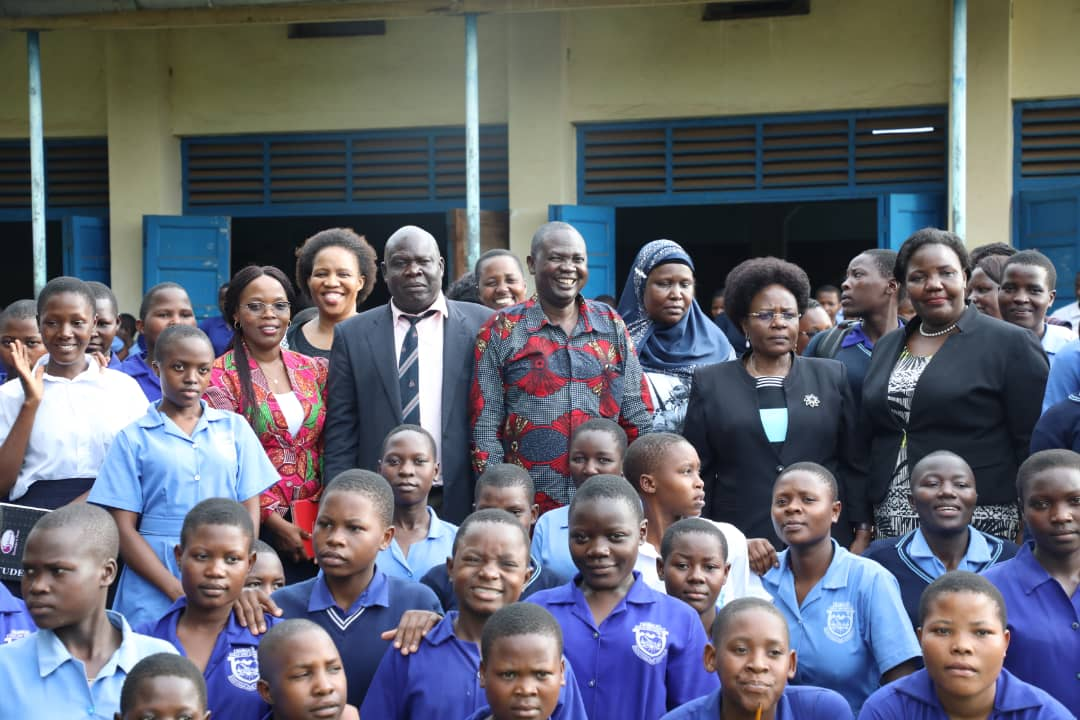 """CEO of ERA and the Minister of Energy and Mineral Development with students at Tororo Girls Secondary School for a career guidance during the """"Women in Energy"""" Campaign 2020"""